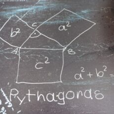 Pythagoras Theorem chalked on concrete - his contribution to Geometry